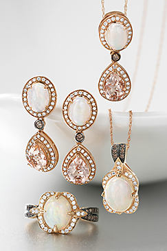 An assortment of fine jewelry including a necklace, earrings and a ring with diamond accents.