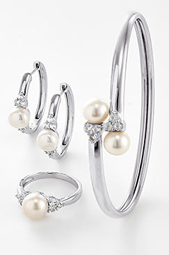 Silver fine jewelry with pearl and diamond accents.