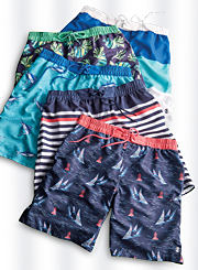 An assortment of men's swim trunks in various prints and colors. Shop swimwear.