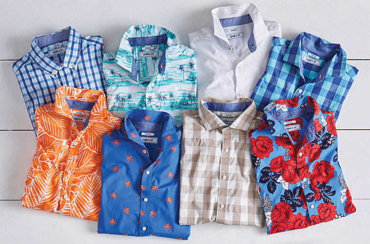 An assortment of men's button-front shirts in a variety of patterns.