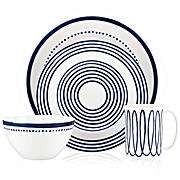 Plates, a mug and a bowl with a blue and white graphic design. Shop Kate Spade dining and entertainment essentials.