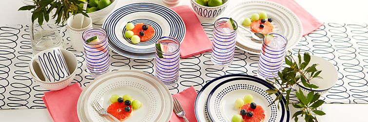 A table set for brunch with Kate Spade dinnerware including plates, glasses, mugs and silverware.