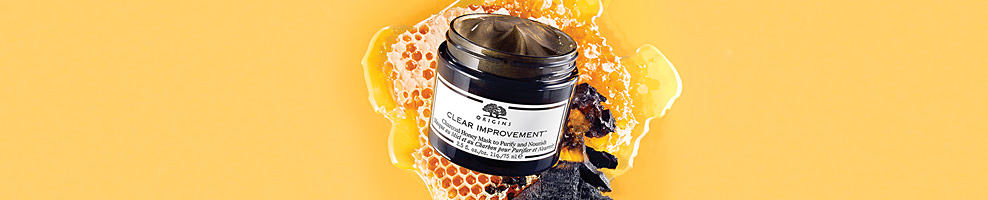 A container of charcoal honey mask. Origins. Bee purified! New Clear Improvement Charcoal Honey Mask. Formulated with Bamboo Charcoal, this purifying mask actively deep cleans and draws out deep dwelling pore cloggers, impurities and debris. Golden Wildflower and Fermented Honey nourish skin. Shop now.