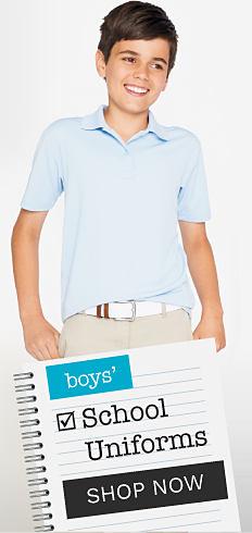 A boy wearing a light blue polo & beige pants. Boys school uniforms. Shop now.
