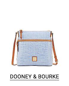 72c759dc43d A light blue handbag with brown leather trim & strap. Shop Dooney & Bourke.