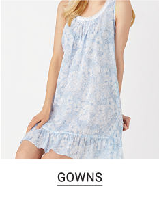 A woman in a blue and white night gown. Shop gowns.