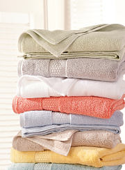 A stack of bath towels in a variety of colors. Shop bath towels.