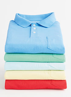 A stack of folded men's polos in a variety of coors. Polos. Shop now.