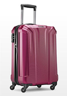 A magenta hardside spinner. Luggage. Shop now.