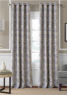 A window with floor length curtains. Shop window treatments.