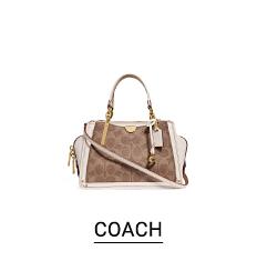 A brown handbag with white strap, handles & trim. Shop Coach.