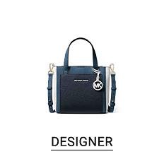 A black leather handbag. Shop designer.