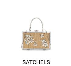 A beige satchel with white trim & flower detail. Shop satchels.