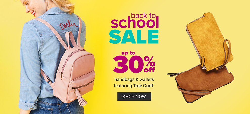 A young woman wearing a denim jacket, blue jeans & a peach backpack purse. Two different styles of brown suede wallets. Back to School Sale. Up to 30% off handbags & wallets featuring True Craft. Shop now.
