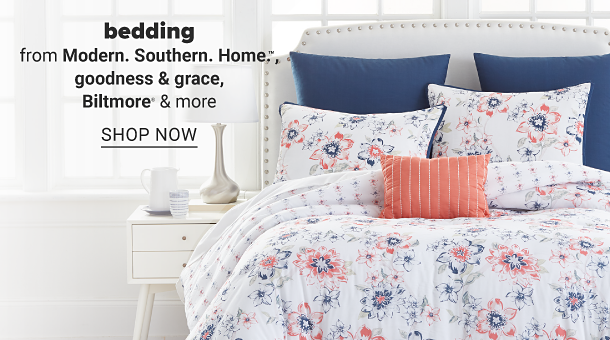 A bed with white bedding with a blue and pink floral print and pillows to match. Bedding from Modern, Southern, Home, Goodness and grace, Biltmore and more. Shop now.