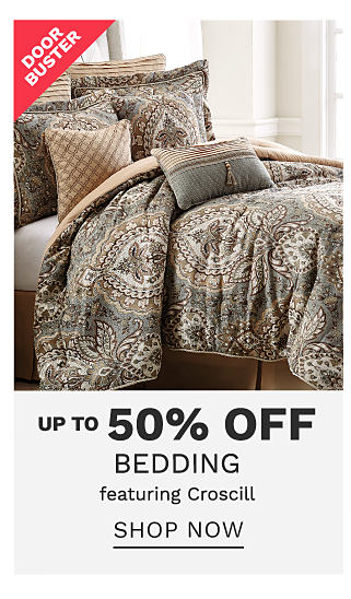 A bed made with a brown, black & white print comforter & matching pillows. DoorBuster. Up to 50% off bedding featuring Croscill. Shop noe.