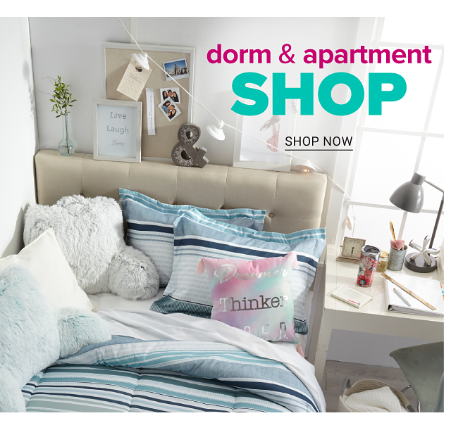 A bed made with a multi colored horizontal striped comforter, matching pillows & white pillows. Dorm & Apartment Shop. Shop now.