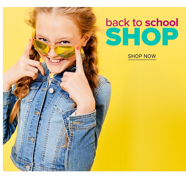 A girl wearing sunglasses & a denim jacket. Back to School Shop. Shop now.