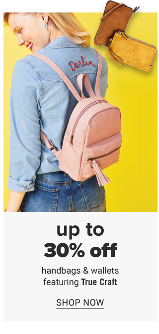 A young woman wearing a denim blue long sleeved button front blouse, blue jeans & a peach backpack purse. Up to 30% off handbags & wallets featuring True Craft. Shop now.