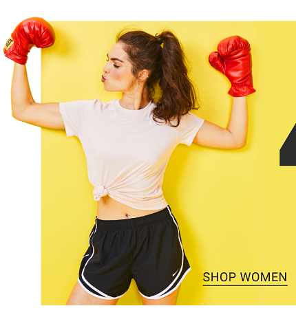 A youing woman wearing red boxing gloves, a white T shirt & navy shorts with white trim. A girl wearing a light blue tee with an Adidas front graphic, multi colored floral print pants & fuchsia sneakers. A young man wearing a black T shirt with a white Champion front graphic & gray shorts. Up to 40% off activewear for the family. Shop women.