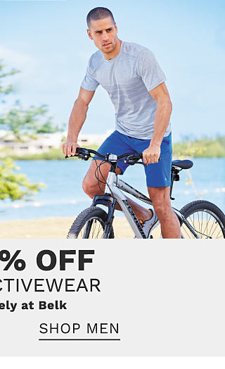 A man on a bicycle wearing a gray T shirt & blue shorts. Bonus Buy. Up to 60% off Zelos activewear. Exclusively at Belk. Shop women.