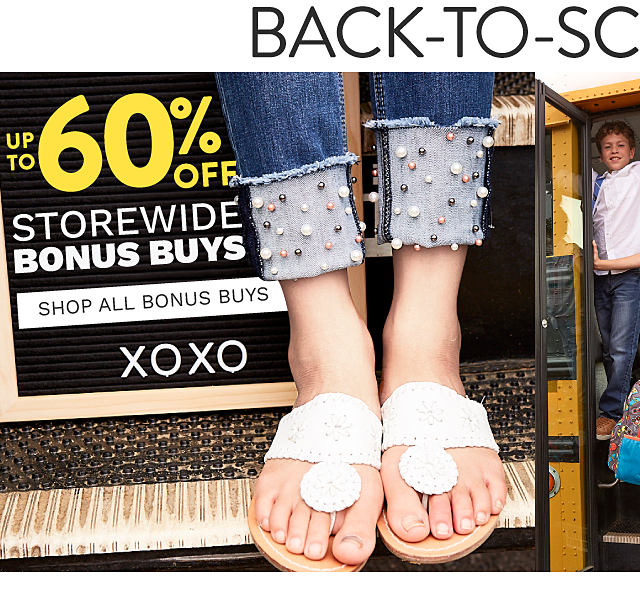 A girl wearing blue jeans with beaded embellishment at the cuffs & white sandals. Back to School Sale. Storewide Bonus Buys. Up to 60% off. Shop all Bonus Buys.
