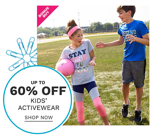 A girl holding a pink volleyball wearing a pink headband, a gray, black & pink Stay True Be You graphic tee & black, pink & gray yoga pants standing next to a boy wearing a blue & white Legend Bound graphic tee, gray shorts & black sneakers. Bonus Buy. Up to 60% off kids activewear. Shop now.