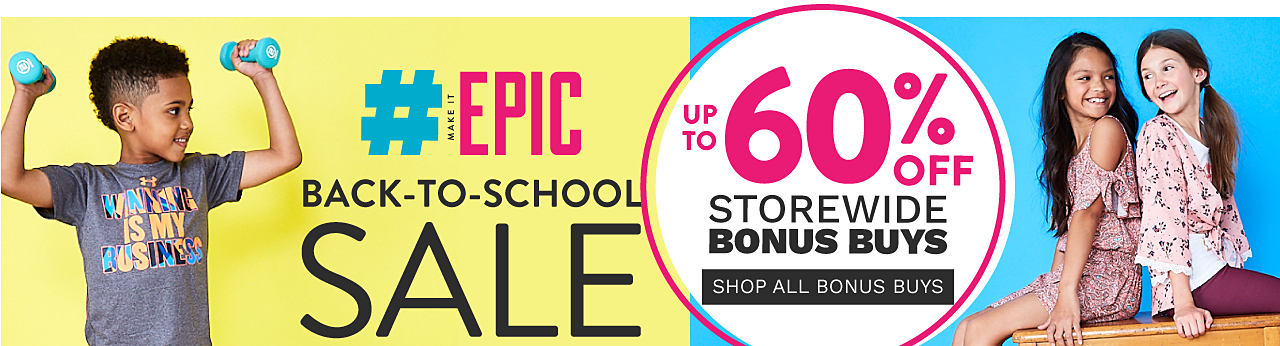 A boy wearing a gray Under Armour T shirt with a blue, black, red & gold Winning is My Business front graphic & blue, black, gold & red patterned print shorts. Hashtag make it epic. Back to School Sale Bonus Buys. Up to 60% off storewide. Shop all Bonus Buys.