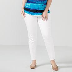 A woman wearing a teal & blue print short sleeved top, white pants & flats. Shop pants.