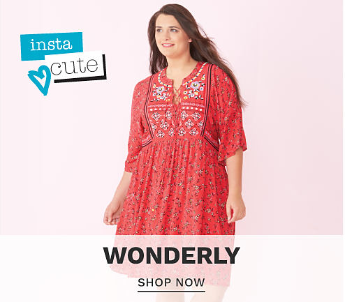 A young woman wearing a red long sleeved dress with a multi colored bandana print. Insta Cute. Wonderly. Shop now.