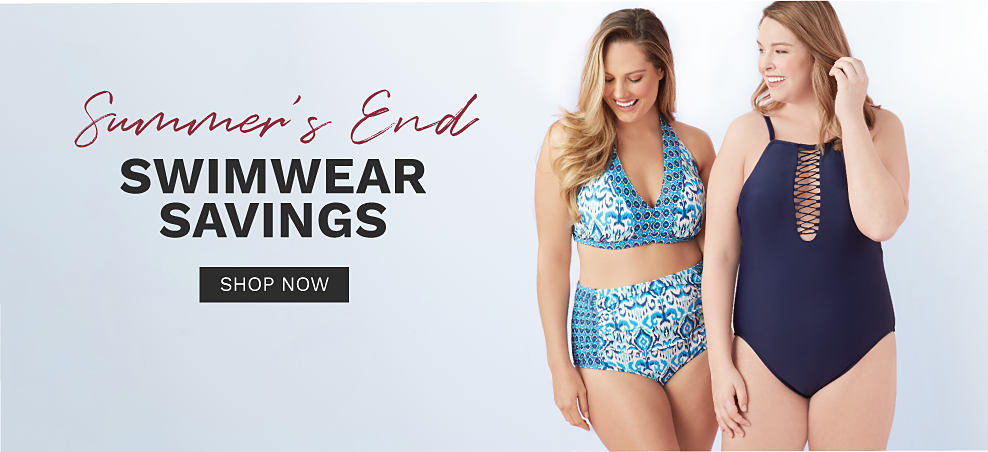 A young woman wearing a light blue, navy & white patterned print 2 piece swimsuit standing next to a young woman wearing a navy 1 piece swimsuit with front lace up detail. Summer's End Swimwear Savings. Shop now.
