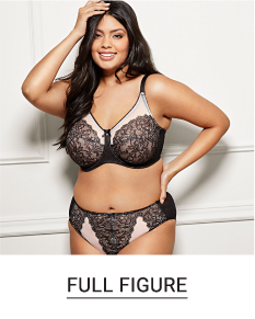 A woman in a black and nude-colored lace bra and panty set. Shop full figure.