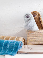 An assortment of bathroom rugs in a variety of colors. Shop bath rugs.