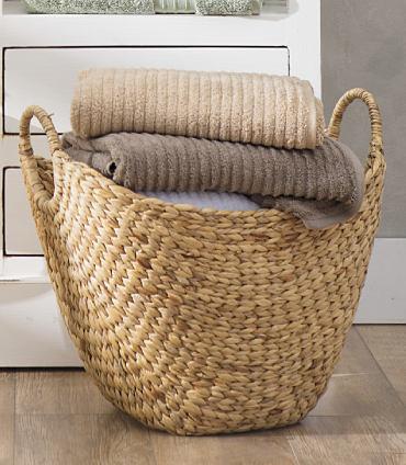 Folded towels in a wicker basket.