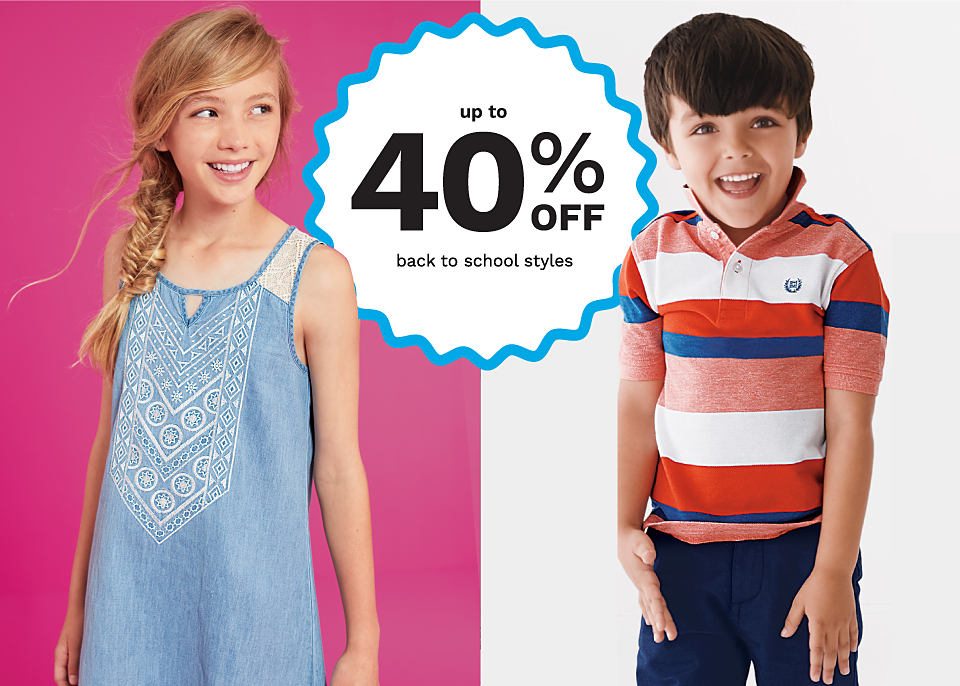A girl wearing a light blue sun dress. A boy wearing a red, white and blue striped polo and navy pants.