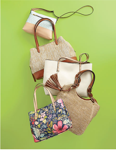 An assortment of handbags in a variety of styles.
