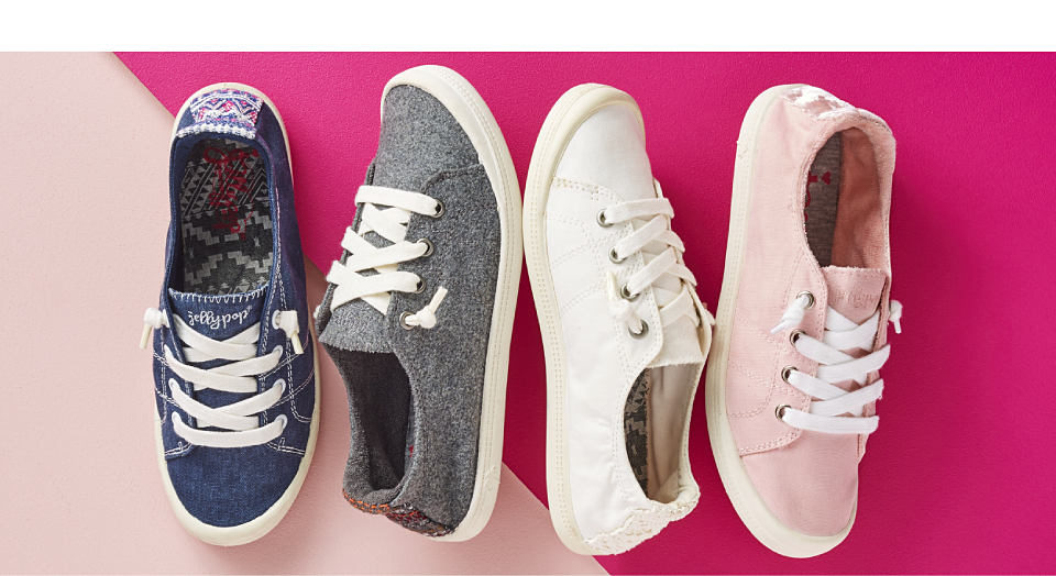 An assortment of sneakers in a variety of colors and styles.
