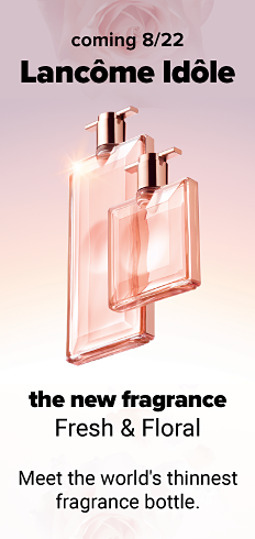 Two bottles of women's fragrance. Coming Soon. Lancome Idole. Arrives August 22. The new fragrance. Fresh & floral. Meet the world's thinnest fragrance bottle.