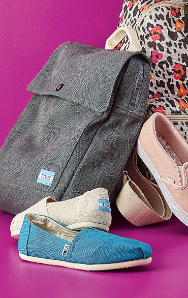 An assortment of colorful shoes from TOMS.
