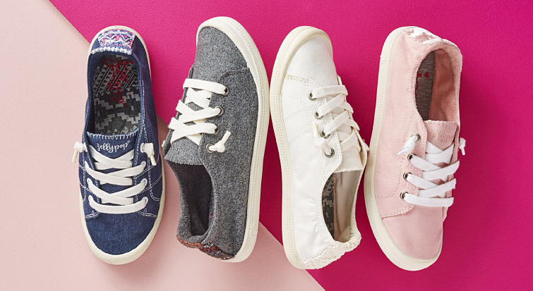 An assortment of fashion sneakers in pink, white, gray and blue.