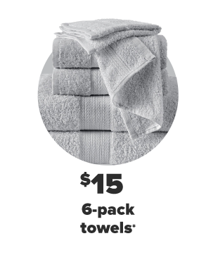 A stack of gray towels of various sizes. $15 6-pack towels.