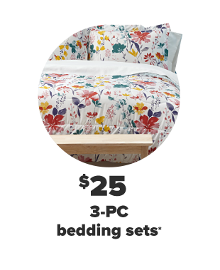 A white bedding set with bright flowers in red, yellow, green and blue. $25 3-PC bedding sets.