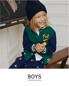 A boy wearing a blue and green jacket with navy pants and a beanie to match. Shop boys.