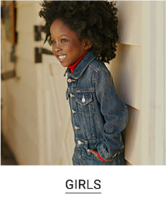 A girl in a red top and denim jacket. Shop girls.