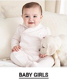 A baby girl in a onesie. Shop baby girls.