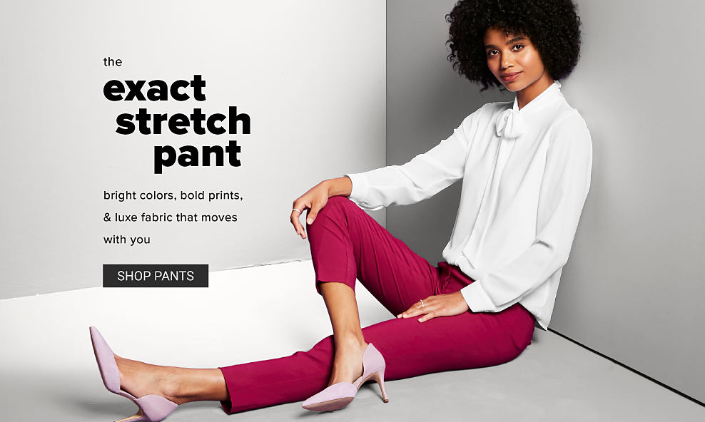 A woman in a white long sleeve blouse, red pants and light pink high heels. The exact stretch pant. Bright colors, bold prints, and luxe fabric that moves with you. Shop pants.