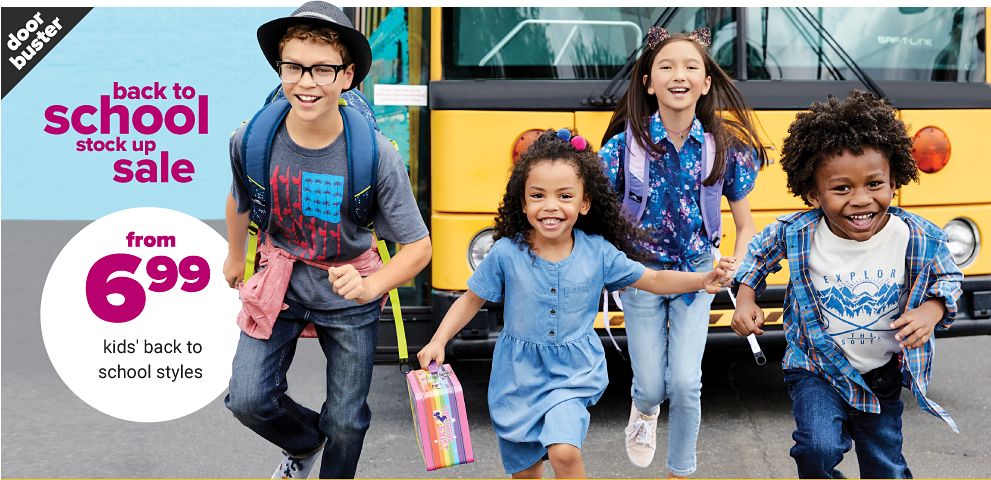 4d524d429bf77 4 kids exiting their school bus, two boys wearing graphic tees and jeans  and two