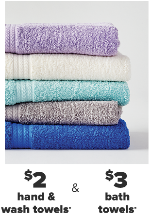 A stack of folded towels in various colors. From $2 towels.