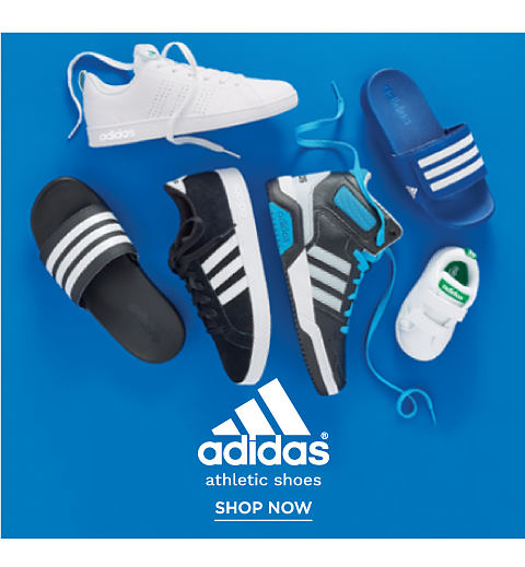 An assortment of Adidas kids athletic shoes.