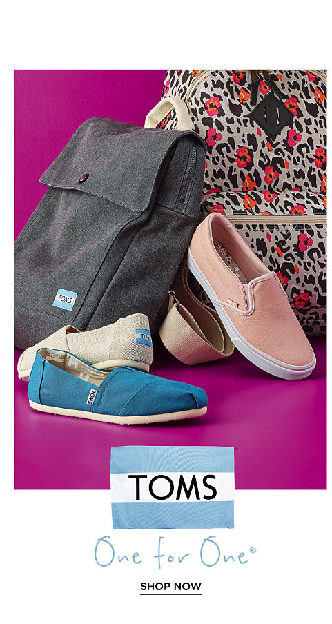 An assortment of TOMS athletic shoes and backpacks.